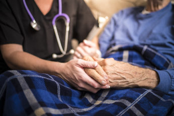 Nurse and man in hospice care