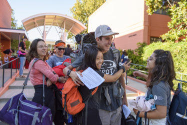 Students who participated in the Stanford Pre-Orientation Trip arrive at Stern Hall.