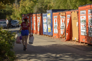 Students retrieve their belongings from shipping containers delivered near their dorms.