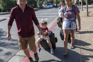 First-year student Maza Hixson moves into Stern Hall with the help of her family, including mom, Janice Hixson, and nephew Niall Blake, 2, who gets a ride from Jim Hixson, her dad.