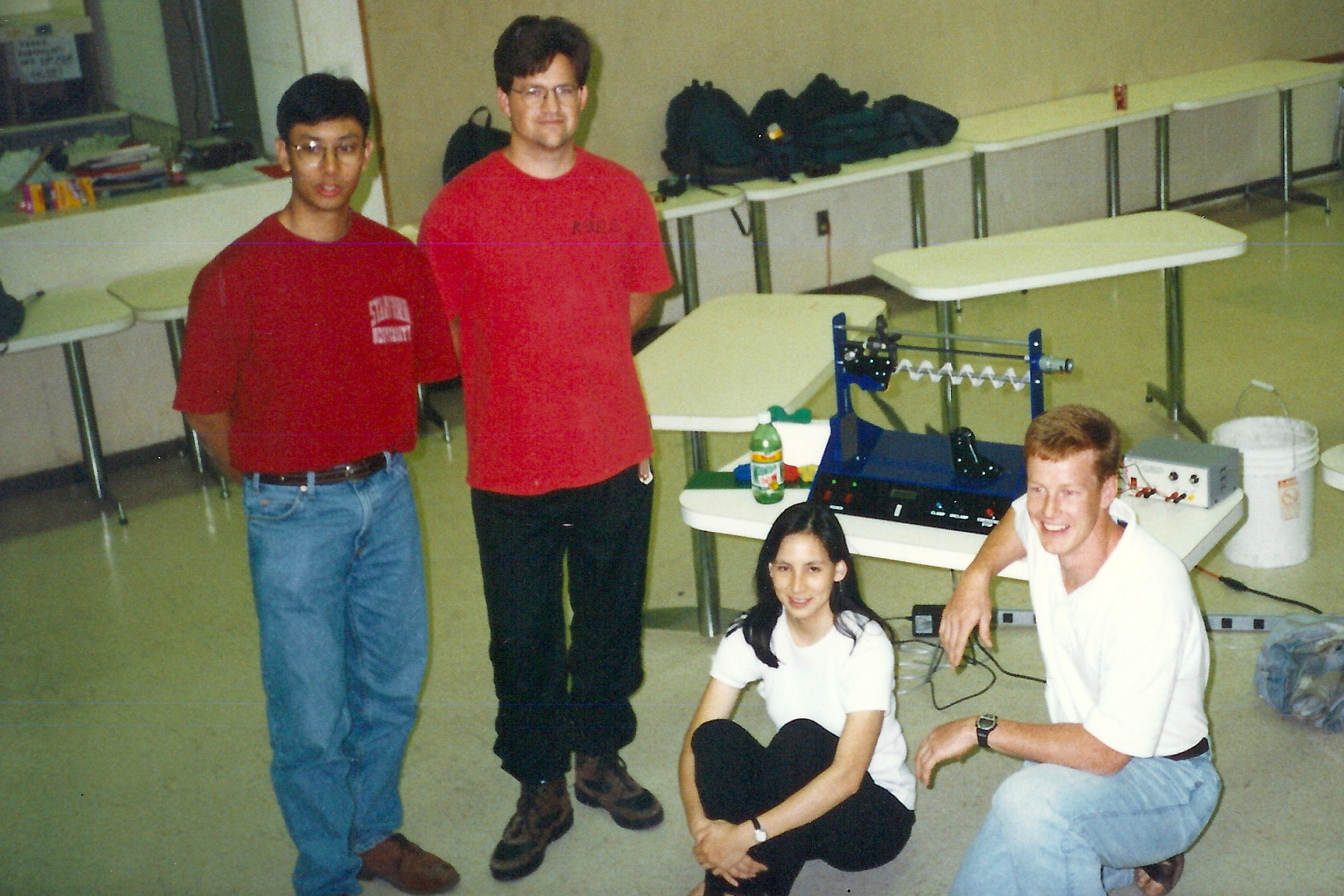 Two students standing and two sitting