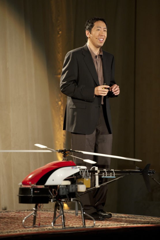 Ng on stage with one of his autonomous helicopters