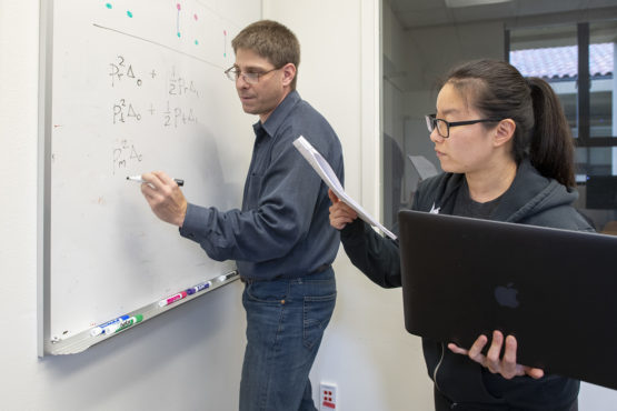 Professor Noah Rosenberg, left, and postdoc Jaehee Kim