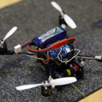 new type of flying, micro, tugging robot called a FlyCroTug.