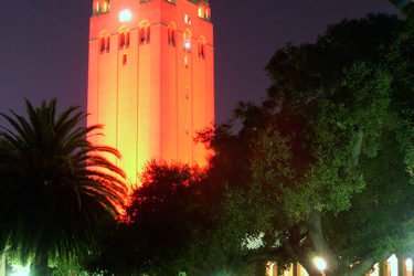 Hoover Tower bathed in cardinal red.