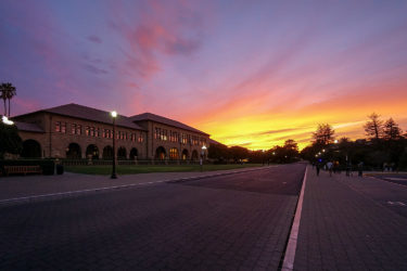 Sunset highlights the outside of the Main Quadrangle.