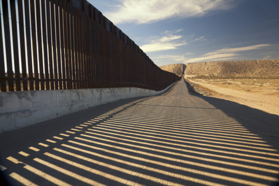 Fence separating United States and Mexico