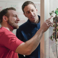 Paul Day and Alan Asbeck with the gecko stickybot III on a window