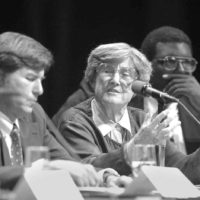 black and white photo of Eleanor Maccoby at a panel discussion