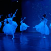 Dancers in white dresses performing the Nutcracker
