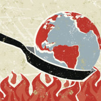 global warming illustrated by a globe being heated in a frying pan over flames