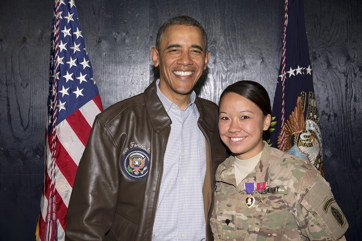 President Barack Obama with U.S. Army Sgt. Rachael Nicol. Obama awards medals to U.S. troops following his remarks to U.S. Troops at a rally at Bagram Airfield in Bagram, Afghanistan Sunday, May 25, 2014