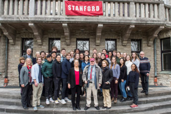 H. George Will (center, with red cap) and his wife, Sigrid (center right), join the students and staff of Stanford's Berlin program at the H. G. Will Center.