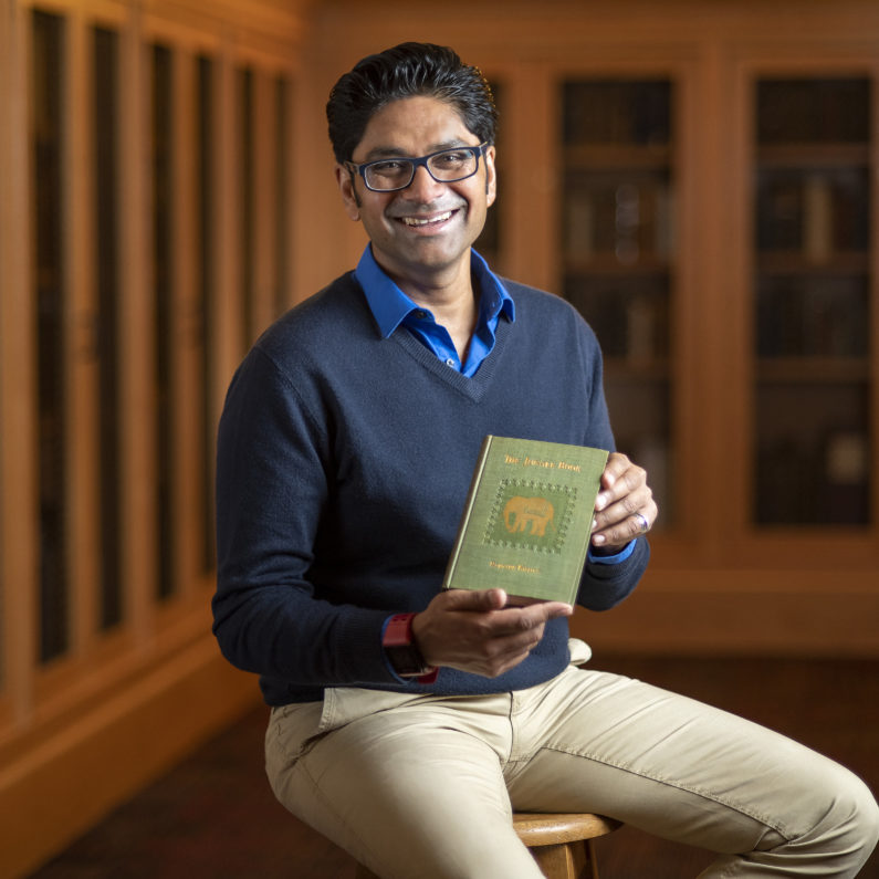 Krish Seetah with the 1894 American first edition of The Jungle Book