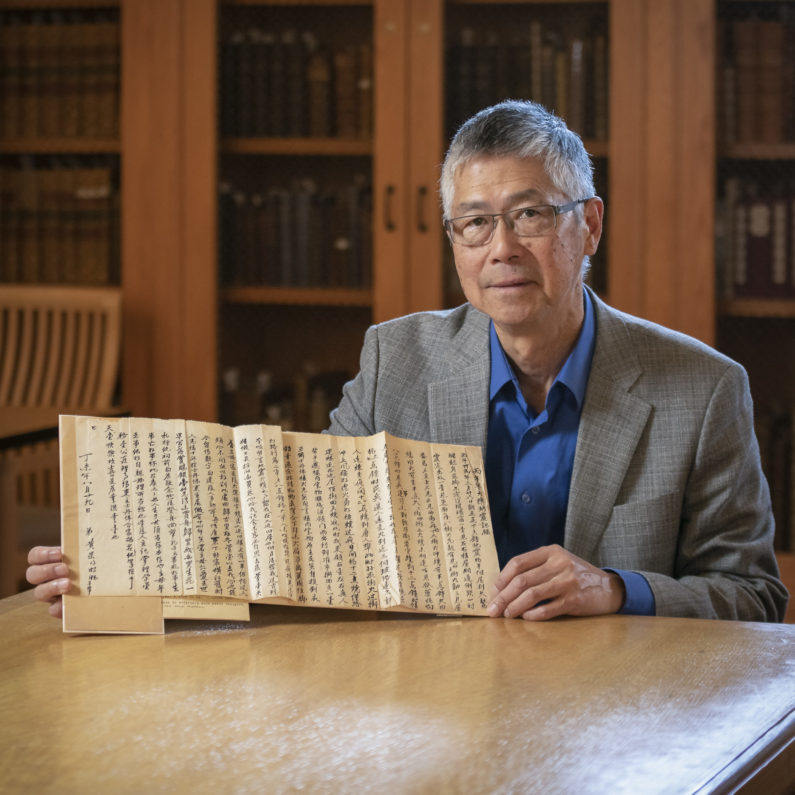 Gordon Chang with a letter from Ah Wing, reflecting on his longtime employment as the Stanford Family's majordomo