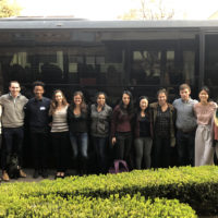 Stanford law students posing in front of bus