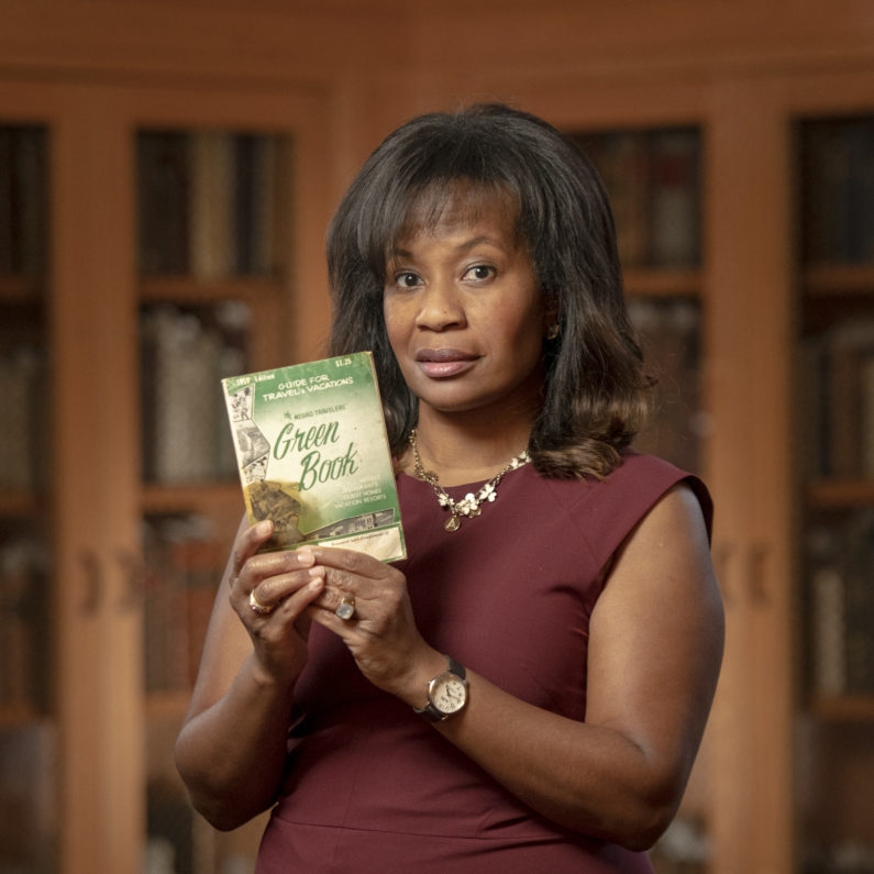 Allyson Hobbs with a copy of The Green Book from Stanford Libraries Special Collections