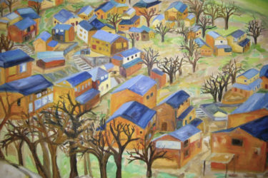Bird's-eye view of homes with blue roofs and leafless trees