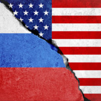 united states of america flag on broken damage wall and half russian white red blue color flag, relationship crisis between russia and usa concept