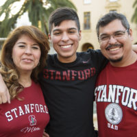 Freshman Javier Covarrubias poses for a photo with his parents in 2017