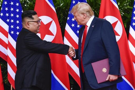 In this June 12, 2018, file photo, North Korea leader Kim Jong Un and U.S. President Donald Trump shake hands at the conclusion of their meetings at the Capella resort on Sentosa Island in Singapore. Trump and Kim are planning a second summit in the Vietnam capital of Hanoi, Feb. 27-28. (AP Photo/Susan Walsh, Pool, File)