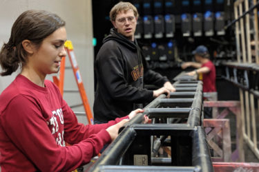 Shop carpenter Kaitlyn Khayat and stage technology specialist Daniel Cadigan