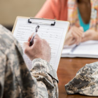 Military veteran filling out paperwork