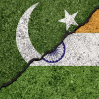 Flags of India and Pakistan painted on cracked wall background/India - Pakistan relations concept
