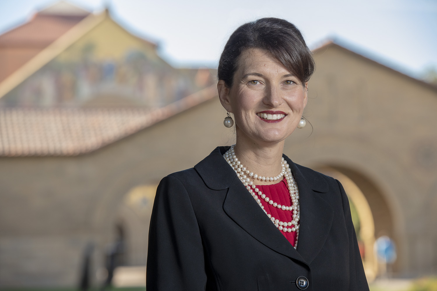 The Rev. Dr. Tiffany L. Steinwert, with Stanford Memorial Church in the background