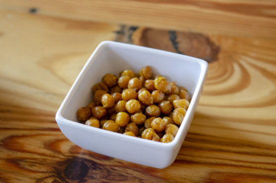 Crispy spiced chickpeas in a white bowl.