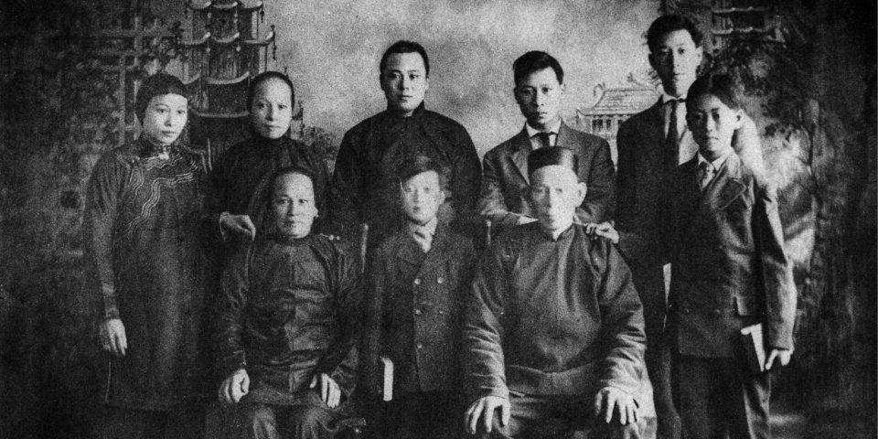 Black and white photo of Hong family posing.