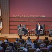 Hoover senior fellows Condoleezza Rice, Niall Ferguson and Stephen Krasner on stage at Hauck Auditorium for lecture March 26, 2019, launching Hoover Institution centennial series.