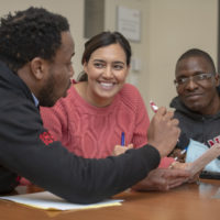 Stanford Graduate School of Business students, from left, Tawanda Mahere, Sarah Martin, and Andrew Matangaidze try to carry out their strategy during an exercise in their negotiations class.