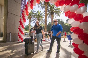 Rhiannon Parker of Laguna Hills, California, walks to Arrillaga Alumni Center with her dad, Clifton.