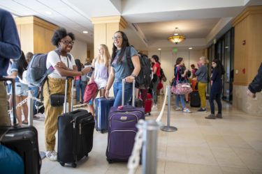 Gabby Crooks of Germantown, Maryland, and Selaine Rodriguez of El Paso, Texas, get to know each another while checking their luggage.