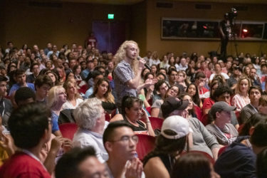 A prospective freshman poses a question at the University Welcome.