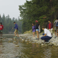 Students in the Cle Elum river