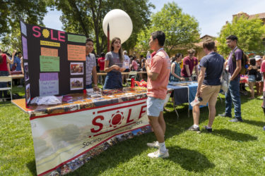Students from the Stanford Society of Latinx Engineers meet with ProFros at the Activities Fair.