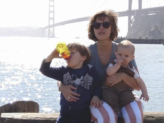 Zuckerman and kids pose by Golden Gate Bridge.