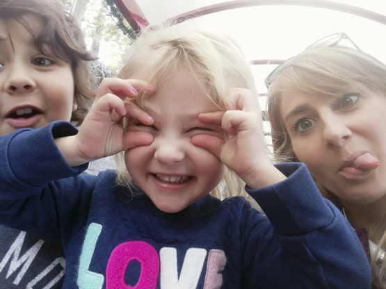 Eagleman and her kids making silly faces.