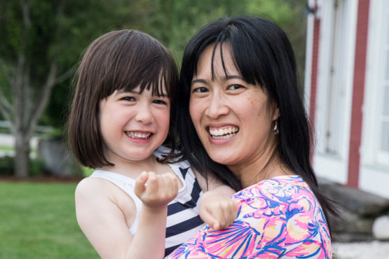Cheuk holding her daughter.