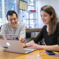 Claire Howlett, right, works with her mentor, George Wang, who earned a doctorate in biology at Stanford in 2009, and is a co-founder of SIRUM, a nonprofit organization that distributes surplus medicine to clinics and pharmacies serving low-income patients.