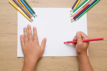 Girl ready to draw picture.