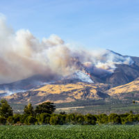 Helicopters fight wildfire in hills above Ventura County, California.