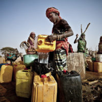 Fari Awade draws water from a well in the community of Natriguel, Mauritania.