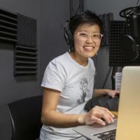 Irena Fischer-Hwang in the space (room 069 in the Packard Electrical Engineering building) that she created to record the podcast The Informaticists. The podcast created and launched in the Autumn 2018 quarter.