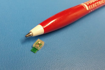 Sound powered chip next to a pen