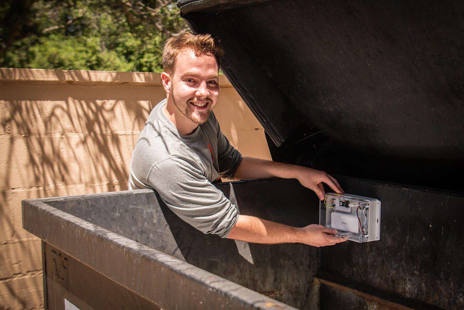 Backus places sensor in dumpster.