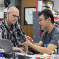Rob Alexander, left, and Tony Chen