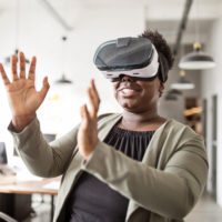 Woman using VR headset and gesturing in air